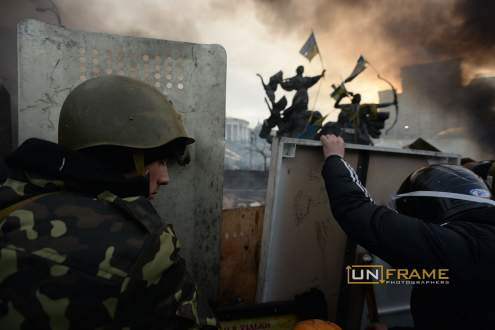 Barricades built under the Maidan independence monument in the last three months are now burning under the repressive assault of the police. Kiev, Ukraine