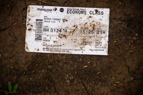 A passenger ticket on Malaysia MH17 crash site, Ukraine