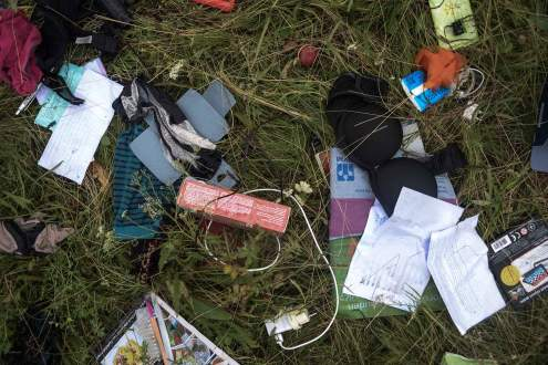 clothes fallen on Malaysia MH17 crash site, Ukraine