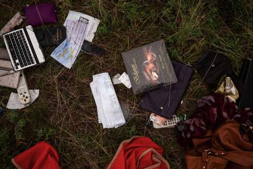 laptop and bags fallen on Malaysia MH17 crash site, Ukraine