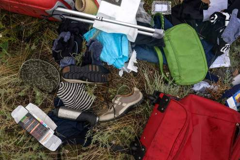 Shoes and bags on Malaysia MH17 crash site, Ukraine