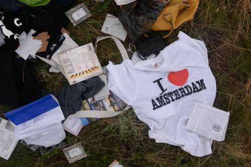 passengers clothes on Malaysia MH17 crash site.
