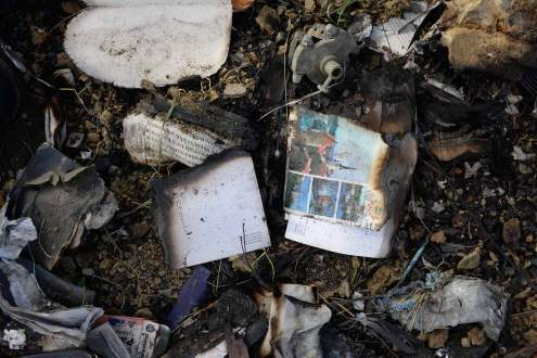Burned debris on Malaysia MH17 crash site