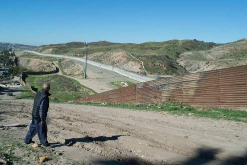 Surveillance patrolling on the US Mexican border fence, Tijuana,
