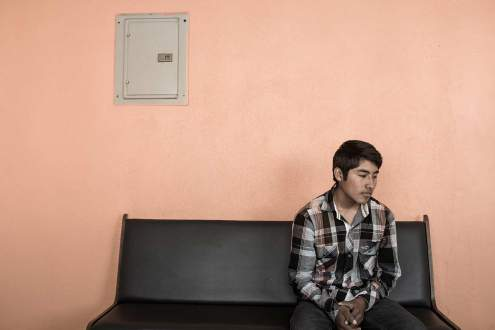 A young man waits in Tijuana for an opportunity to cross the border