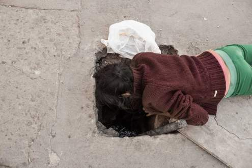 A child looks for rubbish to recycle in sewers. Tijuana