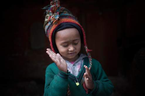 A child takes shelter in a temple past the earthquake