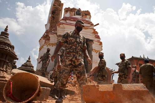 Nepali Army cleans the rubble at the Shoyembho temple, Nepal