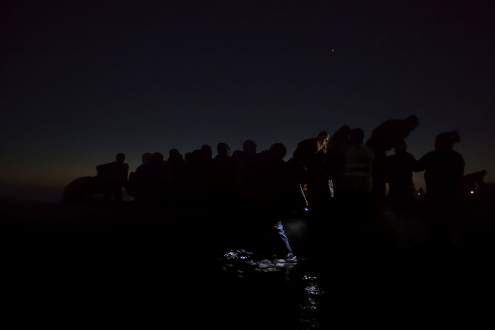 Refugees travel in darkness through Europe