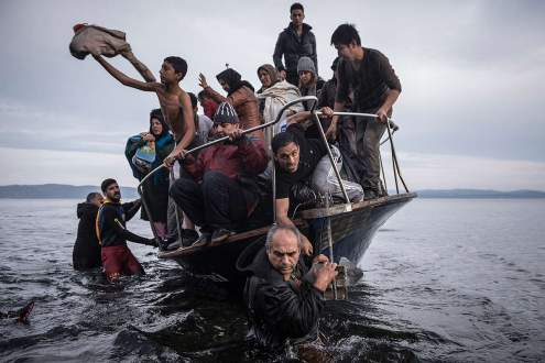 Refugees arrive by boat near the village of Skala on Lesbos, Greece