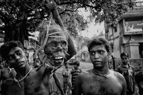 Youth raise a skull during the ritual