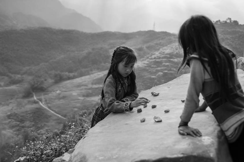 Girls are playing with stones