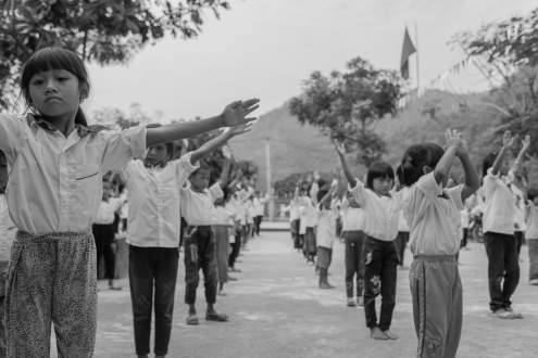 Children are performing to a Communist Party of Vietnam's song