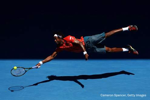 Gael Monfils of France dives for a forehand