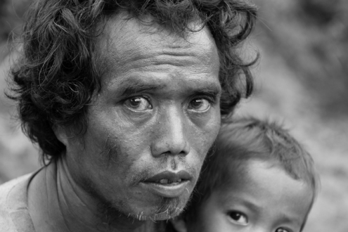 Portrait of a Mlabri man and his child